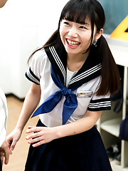 Cute asian student raises her skirt to..