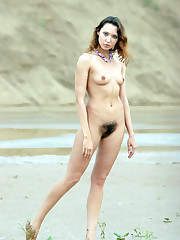 Bare 19yo hottie on deserted beach in..