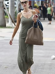 Perky Joanna Krupa heads braless in..