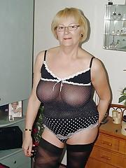 Sexpot mature ladies posing at home in..