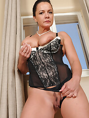 Busty mature woman Pepper Ann peels hot..