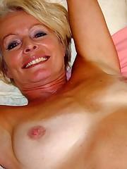 Torrid blonde mature Justine posing..