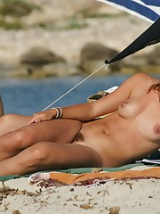 Nudist family sunbathing beach picture..
