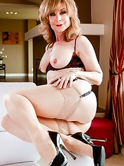Mature honey Nina Hartley flashes her..