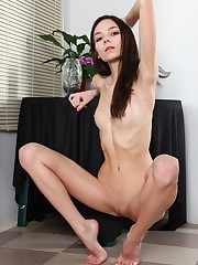 Pretty black-haired babe reveals her..