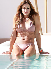 KELLY BENSIMON in Swimsuit at a..
