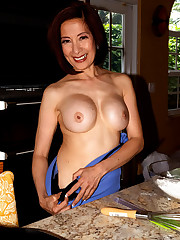 Mature Chinese woman Kim Anh bakes in..