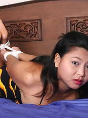 Michikos gagged oriental young woman..