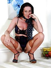 Clad slut Marlyn enjoys uncovering her..