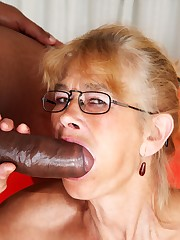 61 years old slut takes a big ebony..