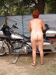 The wifey of a biker posing on a..