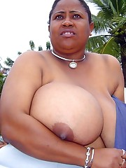 This old ebony mom has a biggest tits,..