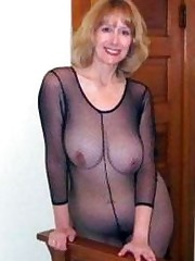 Busty blonde Cougar in fetish fishnet..