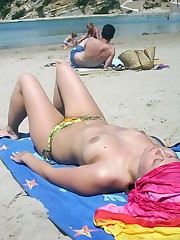 Watch my beloved wife and our hot beach..