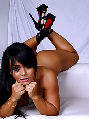 Chunky Latina babe model Akemy posing..