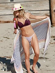 ASHLEY HART in Bikini at a Beach in..