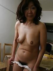 Asian granny Eriko Nishimura taking off..