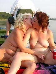 mature lesbians smooching in public
