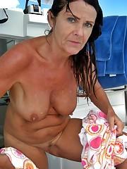 Toples mature women on Itallian beach..
