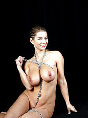 Ball gagged gal with ample tits is..