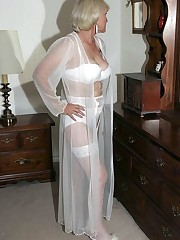 Huge-boobed Cougar in white lingeries..