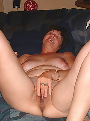 Naked housewife touches herself with..