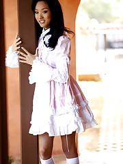 Charming asian young lady Alina hikes..