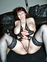 Smiley mature in undergarments rubs her..