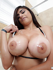 This huge breasted stunner  suck cock..
