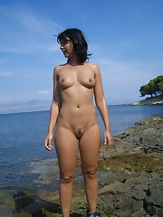 Young girls nudists on the beach bare