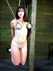 BDSM slave trussed in  and ball-gagged..